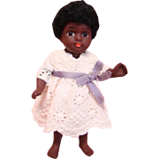 4-1/2 Inch German All Bisque Black Child Doll, Glass Eyes, Closed Mouth, Bare Feet, Curly Black Wig, Jointed Arms and Legs