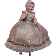 6-1/2 In. Dressel Kister (DK) China Glazed Half Doll with Full Body, Molded Bonnet, Arms Away and Brush-Stroked Hair, Dressed in Silk