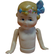 3 In. German Bisque Child Half Doll with Jointed Arms, Big Blue Molded Bow and Headband in Hair, Blue Side-Glancing Eyes