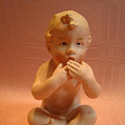 4-1/2 Inch Seated Gebruder Heubach Nude Kiss Throwing Piano Baby