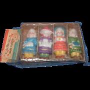 Four Little Bisque Dolls in Original Package