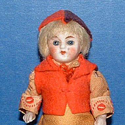 Small All Bisque Doll with Blue Glass Eyes
