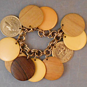Vintage Large Disk Charm Bracelet with Bakelite, Coin, Wood Charms