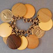 Vintage Large Disk Charm Bracelet with Bakelite, Coin, Wood Charms