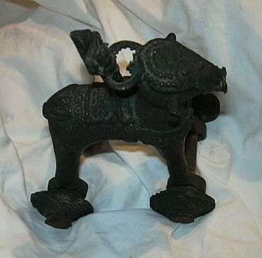 Old Iron Or Metal India Figure On Horse With Wheels