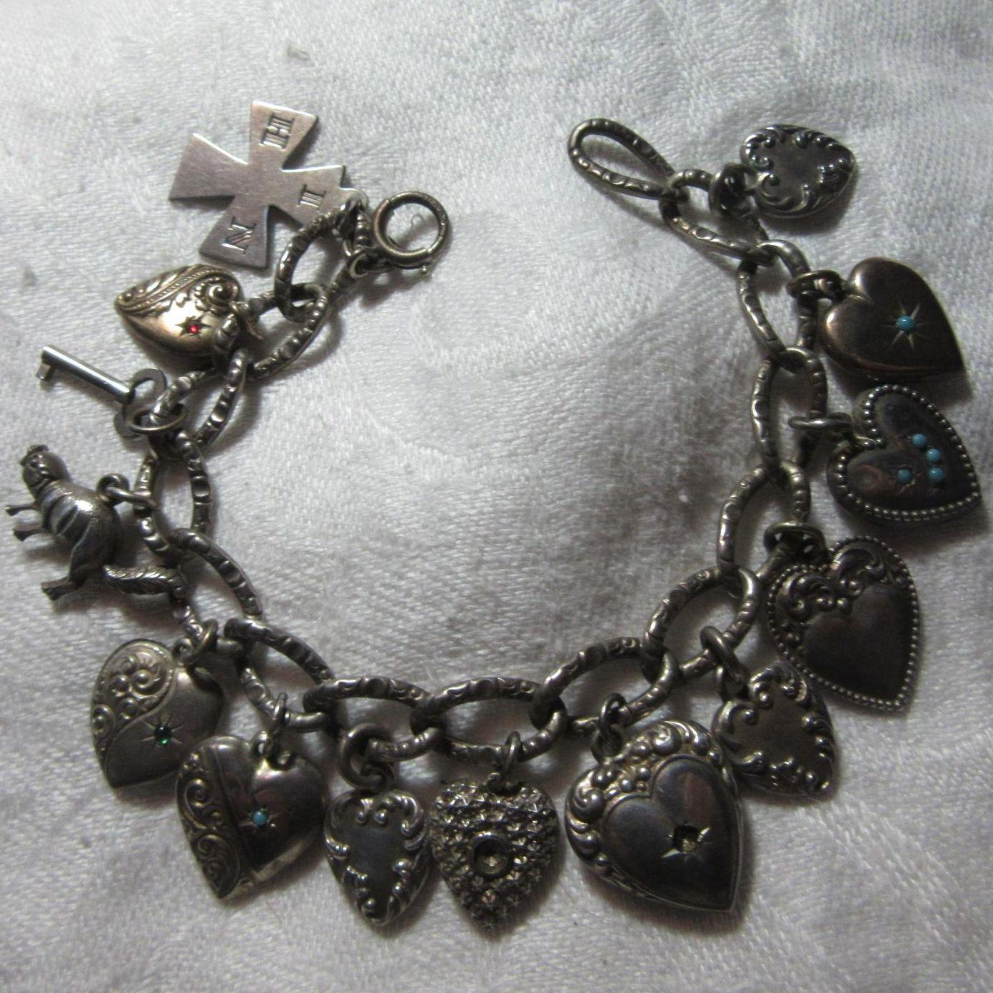 Sterling Charm Bracelet With 14 Hearts & Charms