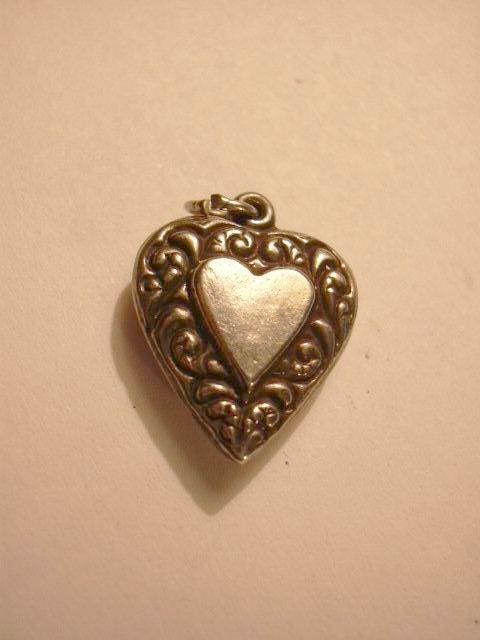 Sterling Silver Heart Charm Big Heart Within A Heart Repousse Borders From A Fine Collection of Puffy & Sterling Hearts