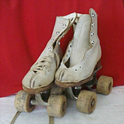 Child's Roller Skates With Wood Wheels By Arrow