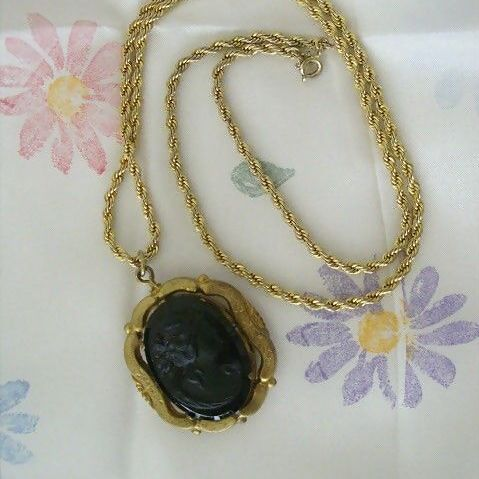 Vintage Black Plastic Cameo Set On Gold-Tone Locket