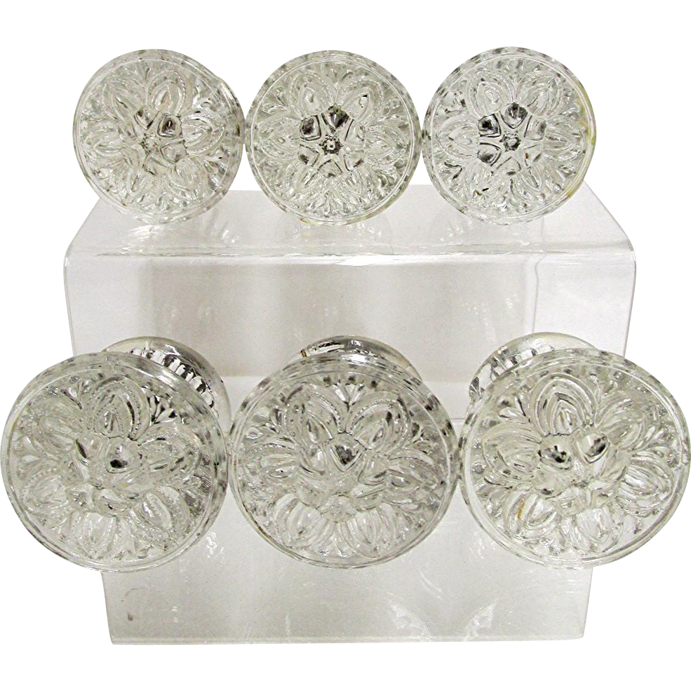 SOLD    Sandwich Glass Relief  Flower Knobs