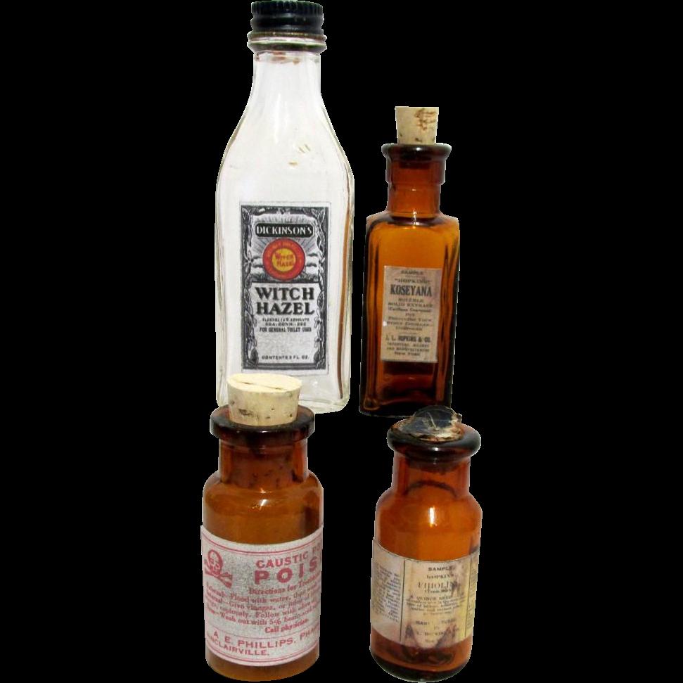 Four Pharmacy Bottles from Drugstore 3 Amber 1 Clear