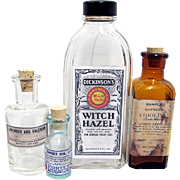 SOLD    Four Glass Drugstore or Pharmacy Bottles with Labels