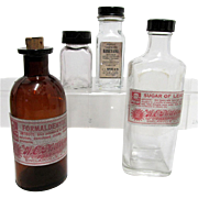 Four Pharmacy or Drugstore Bottles