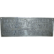 Ducker Company Advertising Sign Cast Metal  Turn of the Century