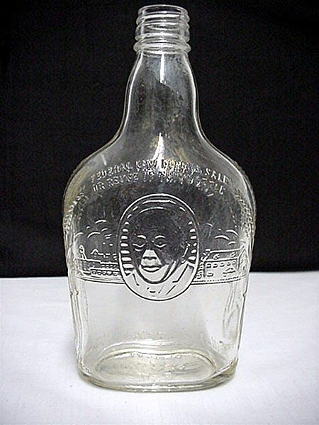 SOLD    Whiskey Bottle Harry Wilken Embossed