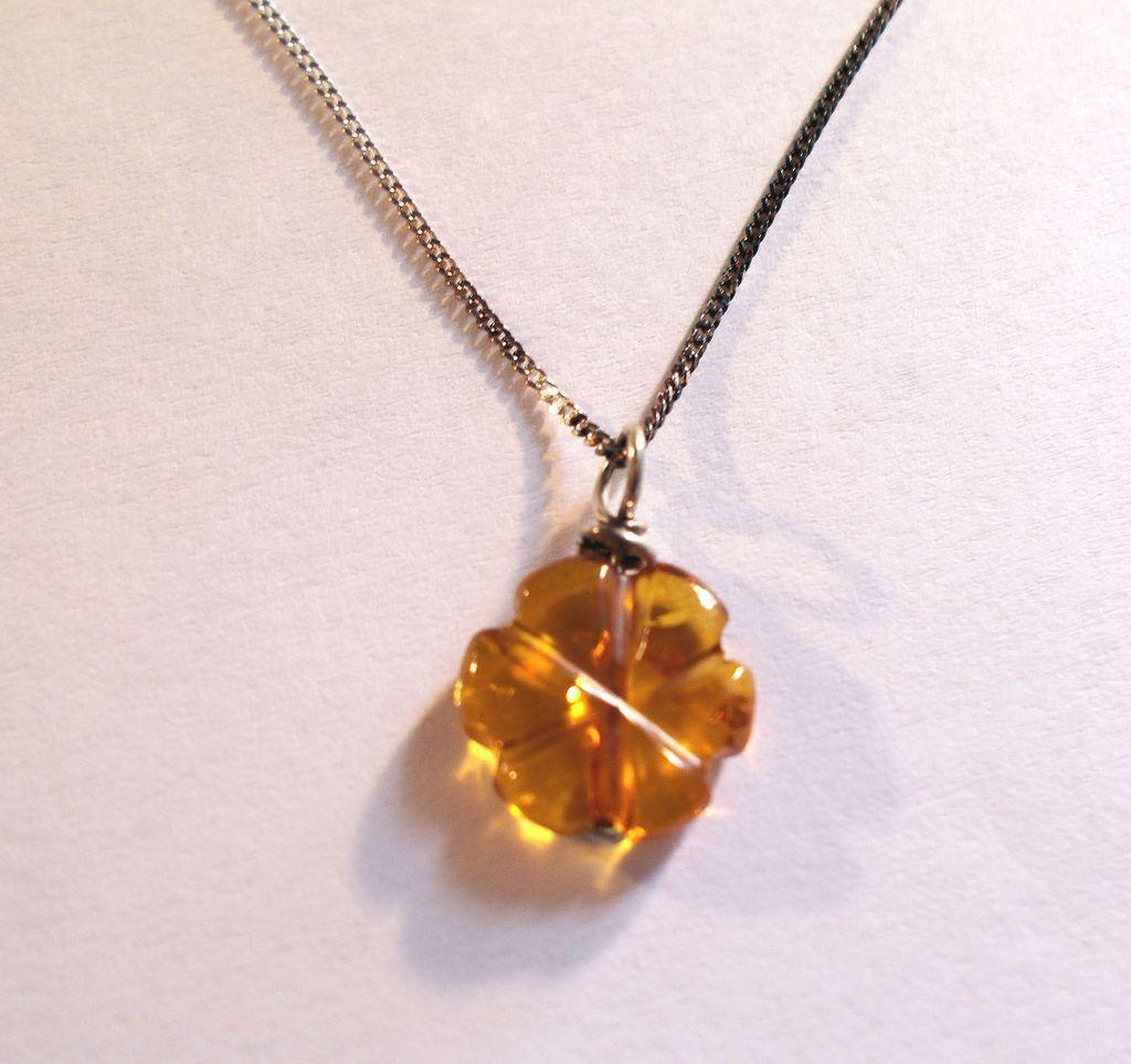 Pretty Carved Amber Pendant
