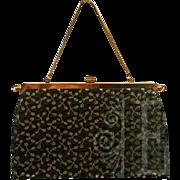Versatile Reversible Black and Gold Handbag