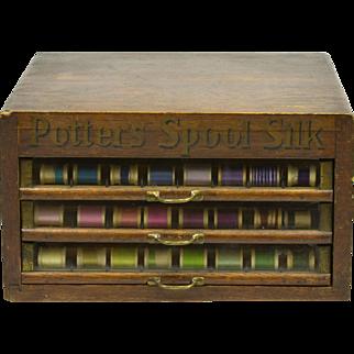 Vintage Potter's Spool Silk Cabinet