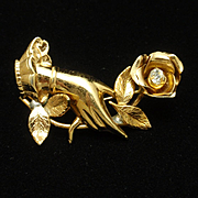 Hand Holding Flower Pin Vintage Coro Pegasus
