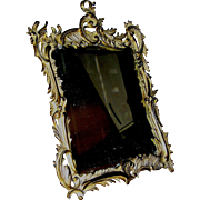 Antique mirror in bronze frame marked by National Bronze & Iron Works, before 1911