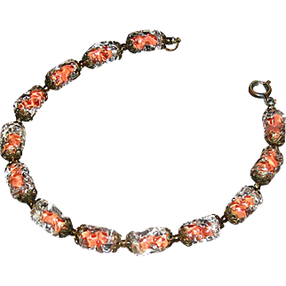 venetian glass ladies bracelet with thirleen piece held in a charming cut-work vintage brass-like metal, early, clasp is working and closes. Early 20th c.