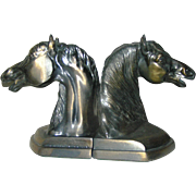 Bookends, spelter or horseheads, in excellent condition circa 1940
