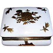 Vintage Porcelain hinged box with a gold rose motif in excellent condition: possibly French or Austria: crossed blue arrow mark with three feathers. Very Nice!