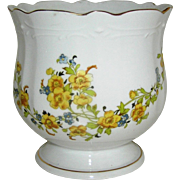 Jardinaire of Cache Pot with a floral motif in yellows, greens, and browns, 20th c.