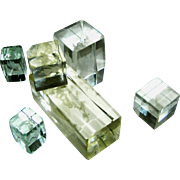 Crystal blocks with motifs floating within of animals, Angels, etc.