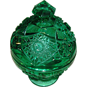 Green Pressed Glass, candy dish, with a covered top, molded is a three sectional mold, and signed K on the bottom.