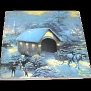 Hot plate, Thomas Kinkade painting depicted, cork backed, lovely!