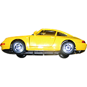 Toy car model, light metal, yellow porsche, with doors and trunk that open and close, VG