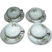 Lot 4 Limoges cups and saucers, floral decor