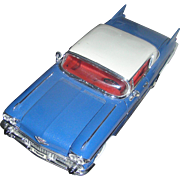 Model of the 1957 Cadilac Elderado Seville. Excellent mounted on a removable base!