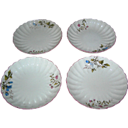 Set of Four vintage china plates with floral motifs and scalloped borders, very early!