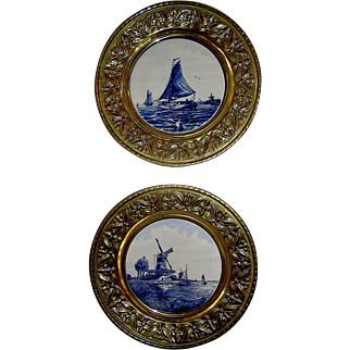 Pair of Delft Tiles in matching, round, brass, frames, mid. 20th c.