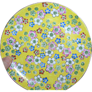 Decorative Hanging plate with yellow, floral motif, circa 1950