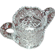 Pressed single creamer with a daisy pattern on the side...highly unusual...very heavy for a single piece...quite nice!