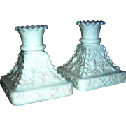 Pair of matching milk glass candlesticks with a grape motif!