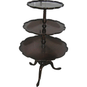 Three tier, solid mahogany stand, circa 1930