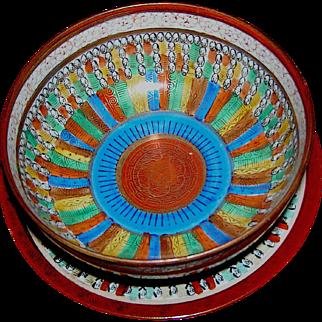 Vintage oriental bowl and under-plate, Thousand Faces motif, Japan, circa 1930