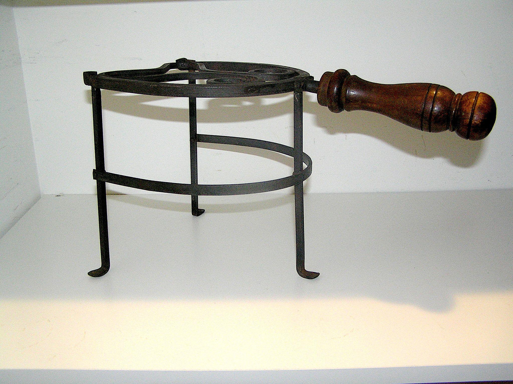 antique wrought iron fireplace kettle or pot stand with heart