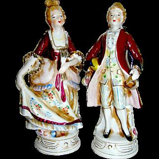 Vintage porcelain stature of a colonial couple, mid 20th c.