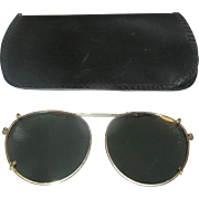 Vintage clip on expandable sunglasses with leather case, green tinted