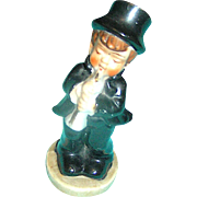 Vintage Figurine of a little boy playing the flute, marked ,Made in Japan