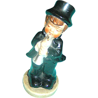 Figurine of a little boy playing the flute, Made in Japan