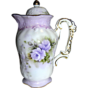 Vintage porcelain, covered little pitcher with a floral motif, mid century