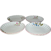 Vintage Meissen porcelain scalloped edged plates or dishes (4) with a blue and pink flower motif and the crossed arrow mark