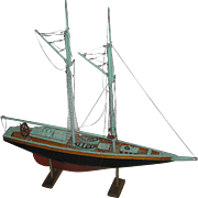Early ship's model or sail boat, all original and hand built of wood and mounted on a stand for you