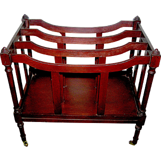 Mahogany canterbury book shelf signed Butler Furniture